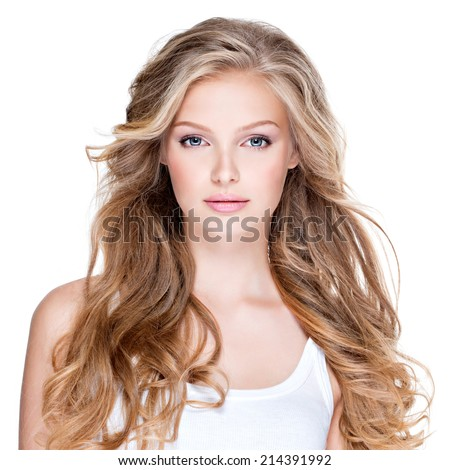 Portrait of beautiful happy young woman with long curly hair - isolated on white. - stock photo