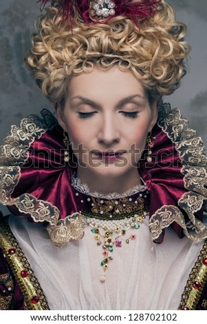 Portrait of beautiful haughty queen - stock photo