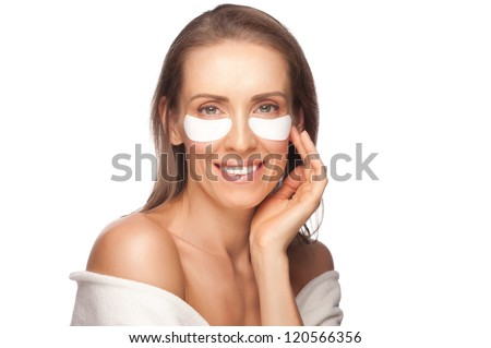 Portrait of beautiful healthy caucasian woman applying gel eye mask . Middle Aged - stock photo