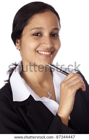 Portrait of beautiful Indian businesswoman at work - stock photo