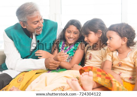 Portrait of beautiful Indian family playing at home. Happy Asian father and children indoors lifestyle.