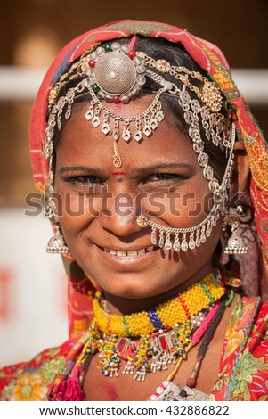 Portrait of beautiful Indian woman in colorful ethnic attire. Jaisalmer, Rajasthan, India . Close up - stock photo