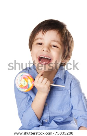 Portrait of beautiful joyful little boy with candy isolated on white background