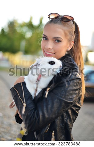 Portrait of beautiful lady with white rabbit