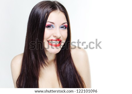 Portrait of beautiful laughing girl with beautiful long hair and a professional make-up. - stock photo