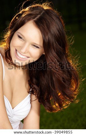 Portrait of beautiful laughing girl with long curly healthy hair - stock photo