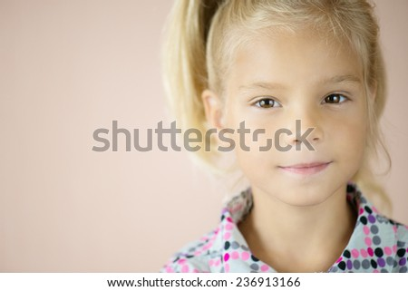 Portrait of beautiful little blonde girl closeup. - stock photo