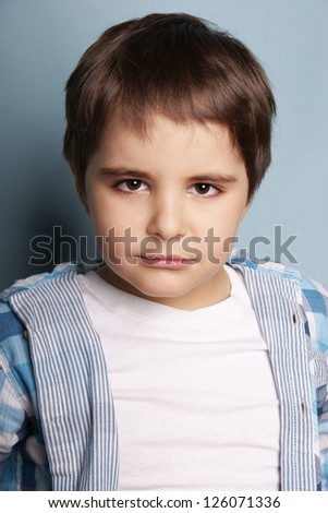 Portrait of beautiful little boy with attentive look, studio shot - stock photo