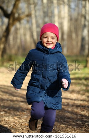 Portrait of beautiful little girl in a white knitted hat autumn - stock photo