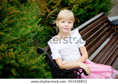 Portrait of beautiful little girl in white dress on the nature - stock photo