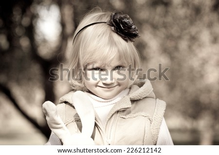 Portrait of  beautiful little girl outdoors - stock photo