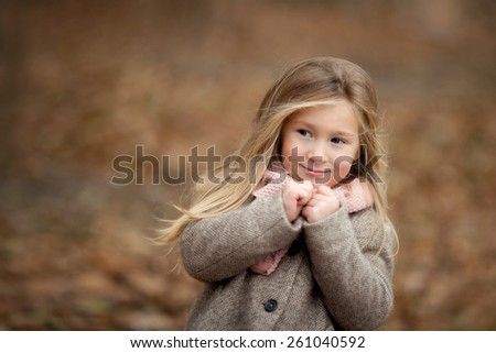 portrait of beautiful little girl with long blond hair on the nature - stock photo
