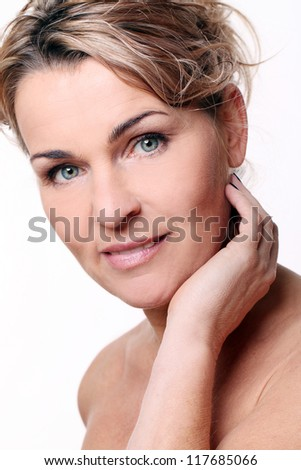 Portrait of beautiful mid aged woman isolated on a white - stock photo