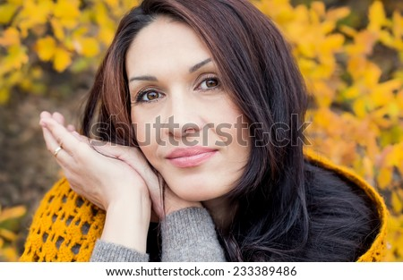 Portrait of beautiful middle age woman walking outdoors in autumn - stock photo