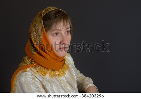 Portrait of beautiful middle-aged Caucasian woman wearing shawl