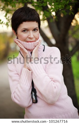 Portrait of beautiful middle aged woman in spring