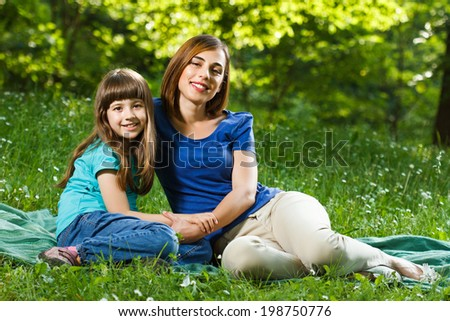 Portrait of beautiful mother and her daughter enjoy in nature,Mother and daughter in nature - stock photo