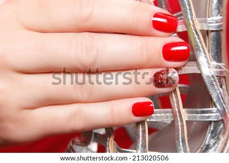 Portrait of beautiful nail polished fingers - stock photo