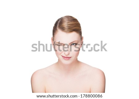 portrait of beautiful natural and expressive woman on white background, makes a wink - stock photo