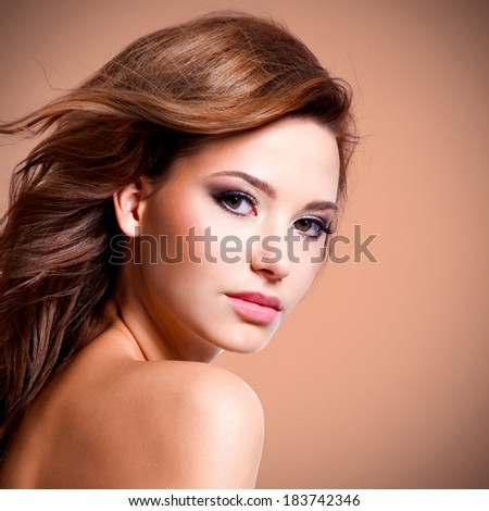 portrait of beautiful pretty woman with brown hairs looking at camera - stock photo