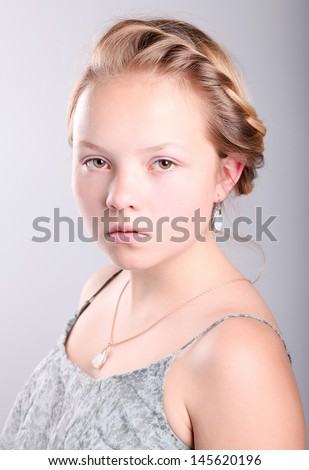 Portrait of beautiful pretty young girl with blonde hair