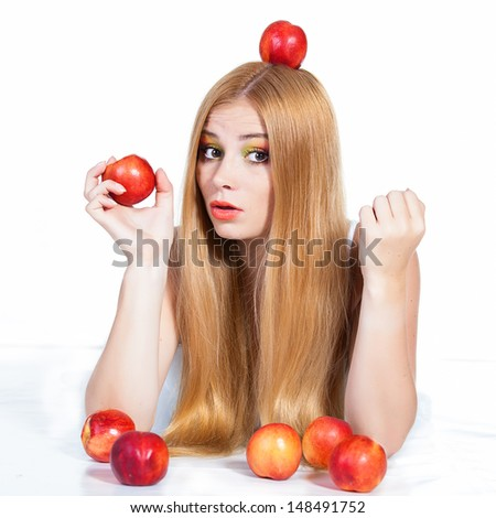 portrait of beautiful red-haired woman with peaches over white background