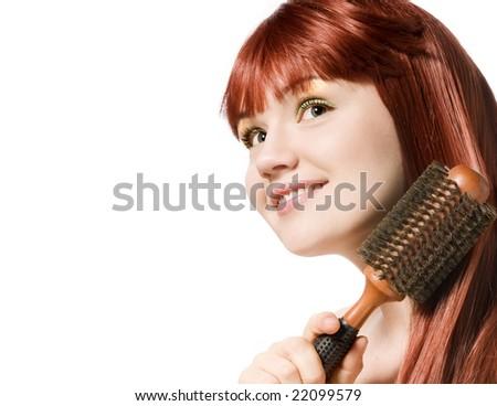 Portrait of beautiful redhead woman brushing her hair - stock photo