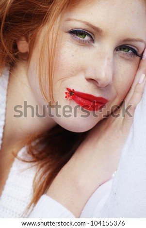 Portrait of beautiful redheaded girl - stock photo
