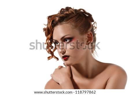 portrait of beautiful redheaded girl with makeup on white background