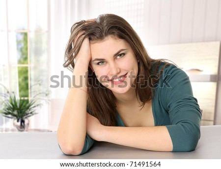 Portrait of beautiful relaxed young woman - stock photo