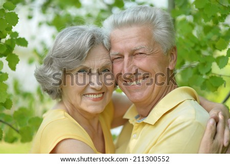 Portrait of beautiful retired couple smiling outdoors on the walk