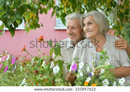 Portrait of beautiful senior couple outdoor in summer park