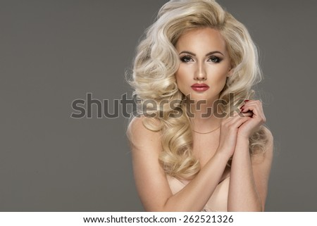 Portrait of beautiful sensual blonde woman with long curly hair. Beauty photo.  - stock photo