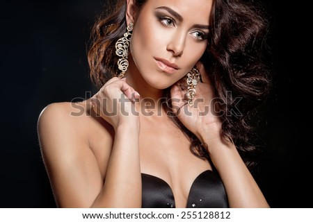 Portrait of beautiful sensual brunette woman with long curly hair - stock photo