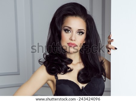 Portrait of beautiful sensual brunette woman with long curly hair. girl looking at camera. Beauty photo. - stock photo