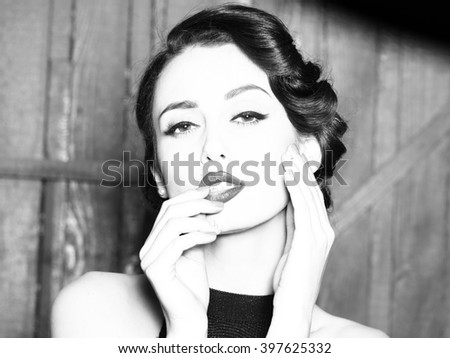 Portrait of beautiful sensual sexy fashionable retro elegant young adult woman with classic hairstyle and red lips indoor on wooden background, horizontal picture - stock photo