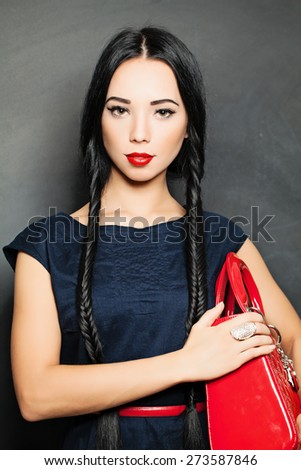Portrait of beautiful sensual woman with elegant fashion hairstyle. Perfect makeup. Girl with pigtail - stock photo