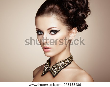 Portrait of beautiful sensual woman with elegant hairstyle. Diamond collar. Perfect makeup. Fashion photo