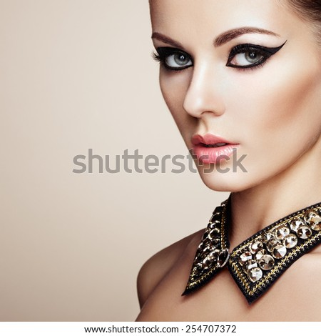 Portrait of beautiful sensual woman with elegant hairstyle. Diamond collar. Perfect makeup. Fashion photo - stock photo