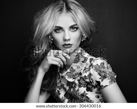 Portrait of beautiful sensual woman with elegant hairstyle.  Perfect makeup. Blonde girl. Fashion photo. Jewelry and dress. Black and white - stock photo