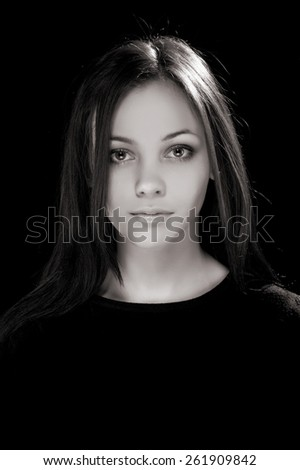 Portrait of beautiful sexy brunette girl on a black background - stock photo