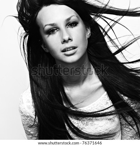 Portrait of beautiful, sexy brunette girl with wind in hair - stock photo