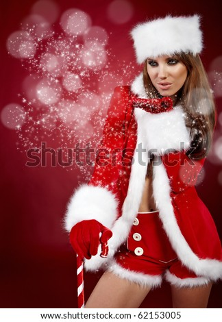 Portrait of beautiful sexy girl wearing santa claus clothes - stock photo
