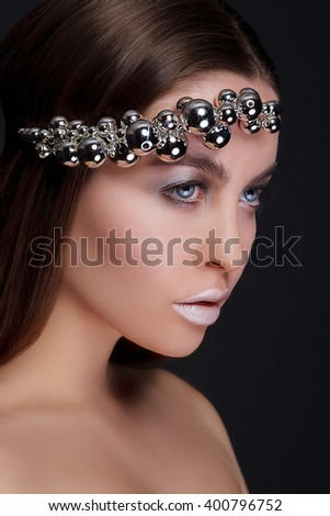 Portrait of beautiful sexy girl with silver makeup close-up