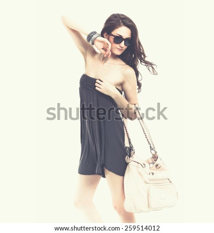 Portrait of beautiful sexy in sunglasses with bag  - stock photo