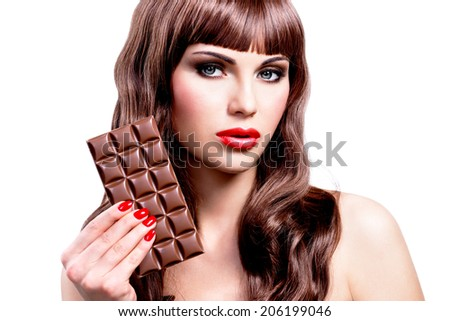 Portrait of beautiful sexy woman with bar of chocolate. Closeup face with bright makeup, isolated on white.