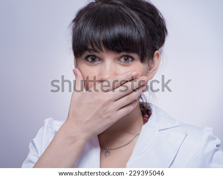 portrait of beautiful shy female stylish woman covering her face - stock photo