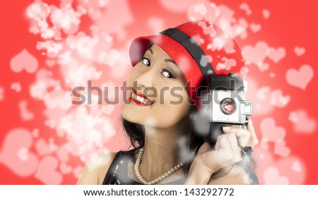 Portrait of beautiful smiling asian girl taking photos filled will heart shape happiness. Photography love - stock photo