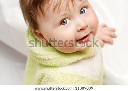 portrait of beautiful smiling baby on white background - stock photo