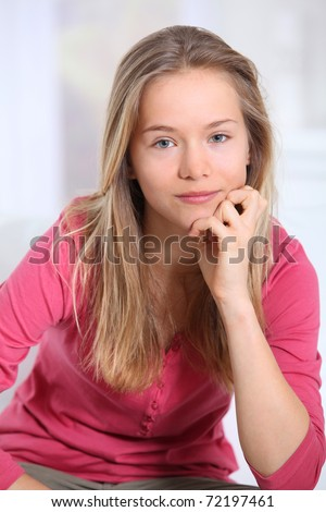 Portrait of beautiful smiling blond girl - stock photo